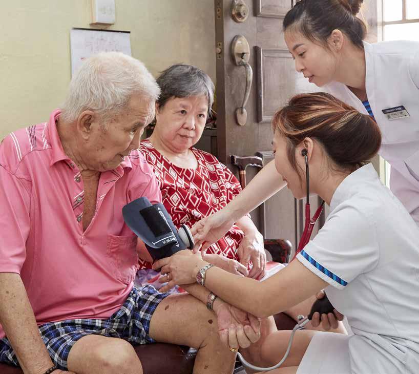 During home visits, Community Nurses Ms Jovin Ang (left) and Ms Yiong Li Lin check Mr Leong Hoong Tan's blood pressure, while his sister, Mdm Leong Yoke Hing, looks on.